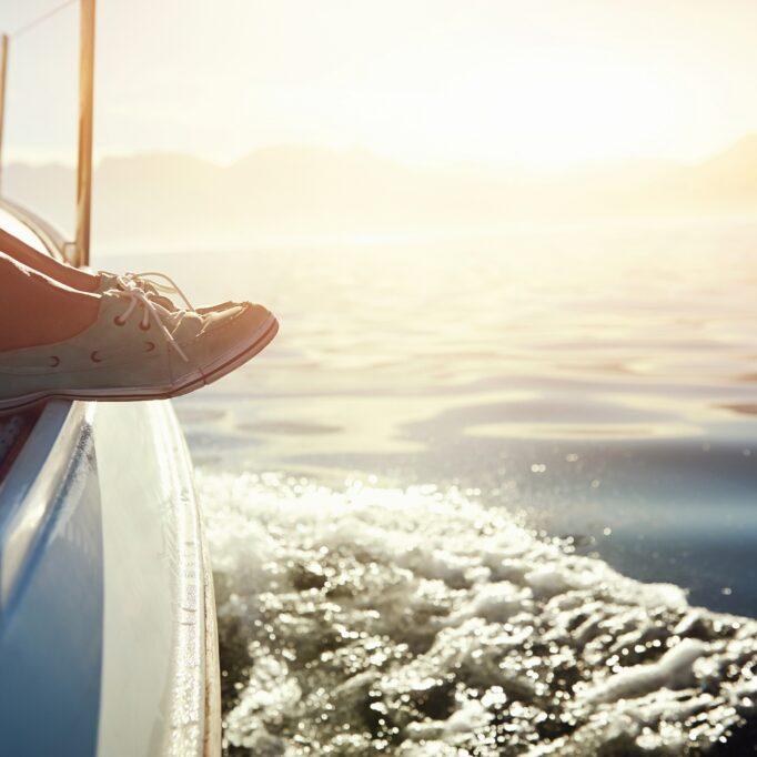 feet-on-boat-sailing-sunrise-lifestyle-