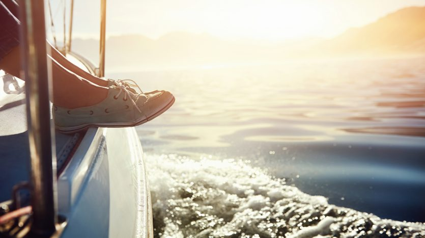 feet-on-boat-sailing-sunrise-lifestyle-