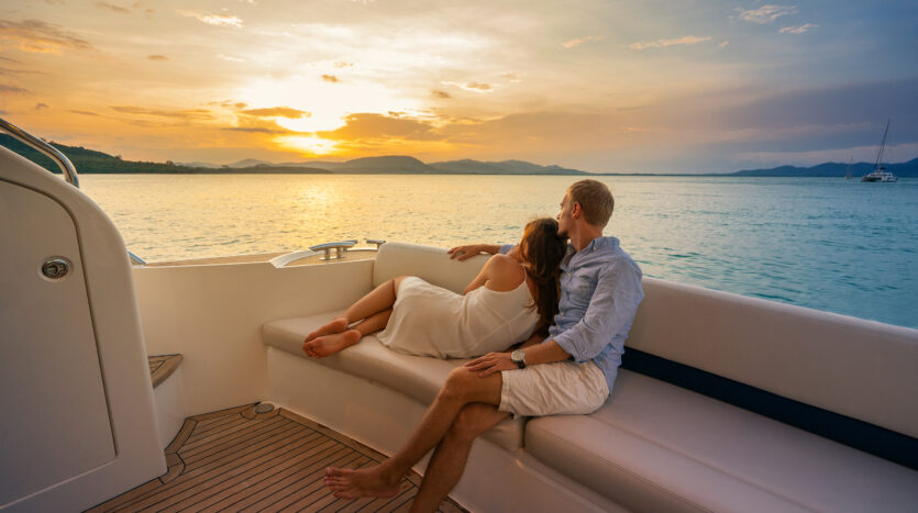 Romantic-relaxing-vacation-Beautiful-couple-looking-in-sunset-from-the-yacht.