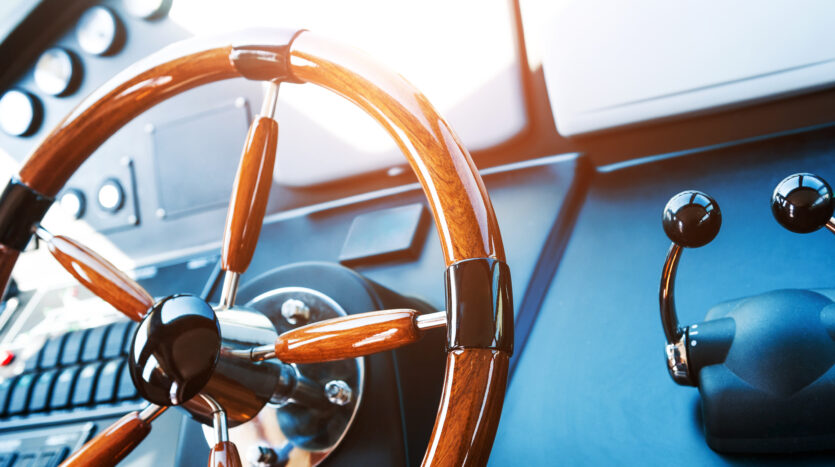 Steering wheel on luxury yacht.