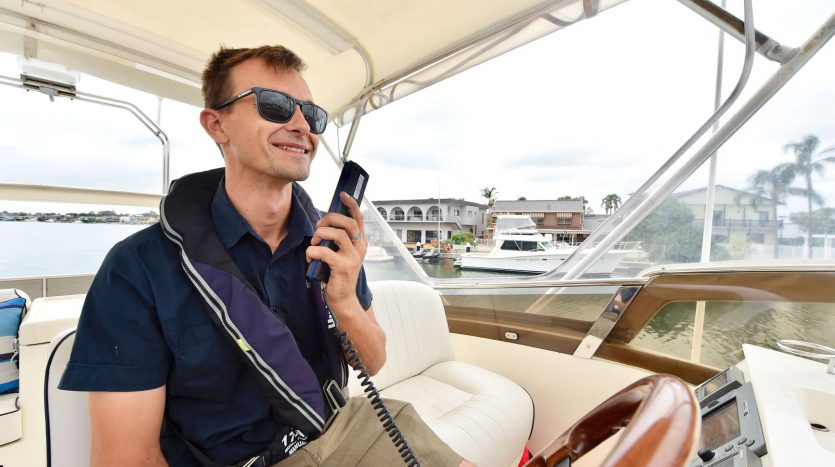 YACHT BROKER LIAISON DRIVING BOAT ON RADIO